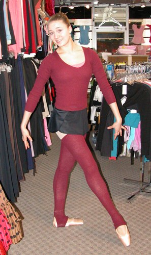 Cecilia is wearing a Harmonie V-neck sweater, Saxo Bur K4, $49.99 over a Coral Rose Camisole Leotard, Style 2341, $36.99; a Black Danskin Pull On Skirt, Style 4363, $24.99; and a Harmonie Stirrup Leg Warmers, $34.99. Available at <a href='http://www.onstagedancewear.com'>OnStageDancewear.com</a>.