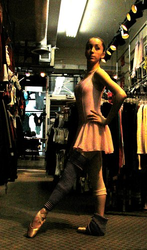 Emma is wearing a PPK Seamless Skirt from the Premiere Collection by Body Wrappers, style P984, $19.99; 2 ply sweater knit Boot toppers/Leg warmers, $6.99; and a pink Kitri by Wear Moi, $39.00. Available at <a href='http://www.onstagedancewear.com'>OnStageDancewear.com</a>.