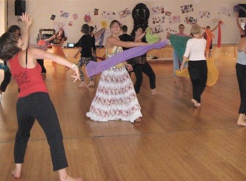 A scarf dance in yoga class