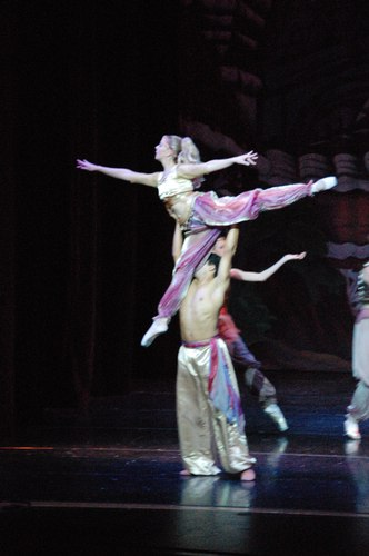 Kirsten Heinrich lifted by her partner, Raymon Ashley, as guest artists in The Nutcracker for Black Mountain Dance Centre.