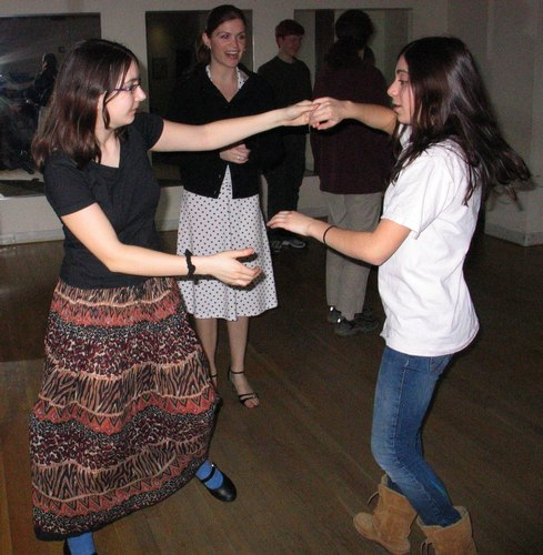 Tili Sokolov, 16, and Molly Zimetbaum, 15, practice a dance move at Arthur Murray Studio in Boston as teacher Christine McCarthy looks on approvingly.