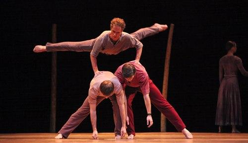 Houston Ballet's program: Of An Era Ballet: Jardi Tancat choreographed by Nacho Duato Dancers: Oliver Halkowich (top) cart wheeling over Ian Casady & Connor Walsh