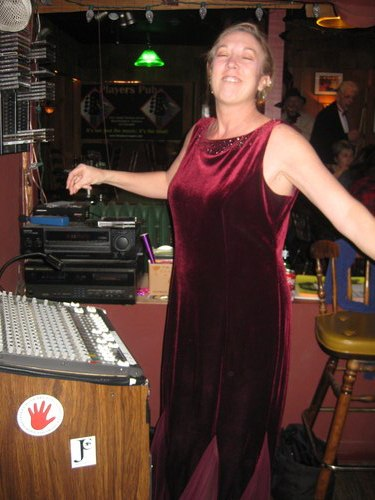 Sheryl Daniels, Players Pub sound woman, dancing alone with her eyes closed at an Obama Inauguration party