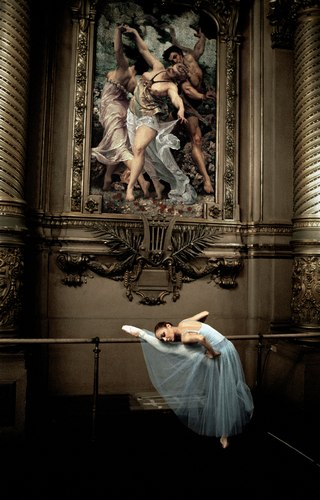 A dancer in one of the Paris Opera Ballet's grand spaces